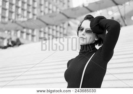 Ambition challenge, success concept. Woman in sunglasses on stairs. Fashion and accessory. Girl with brunette hair in black clothes. Look beauty style. Parisian woman poster