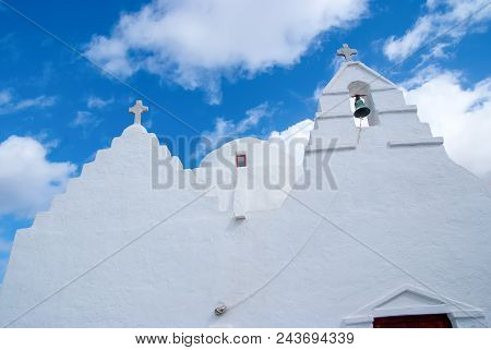 Chapel Building Architecture Detail In Mykonos, Greece. Church Bell Tower And Dome With Crosses. Whi