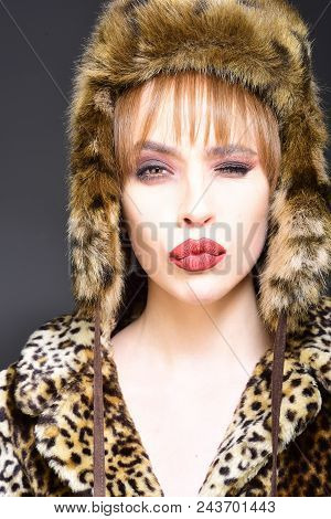 Winter Woman In Luxury Fur Coat And Hat. Beauty Fashion Model Girl In Leopard Fur Coat. Perfect Make