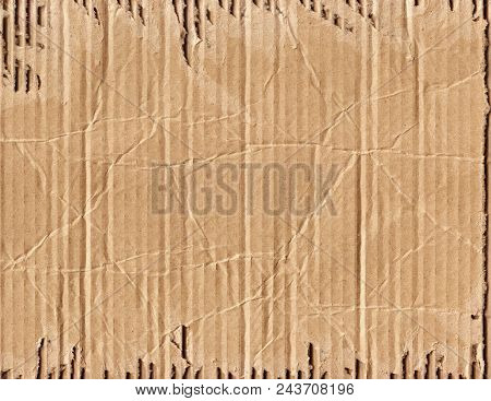 Cardboard, A Sheet Of Light Brown Old Broken Cardboard With Traces Of Cracks And Kinks.