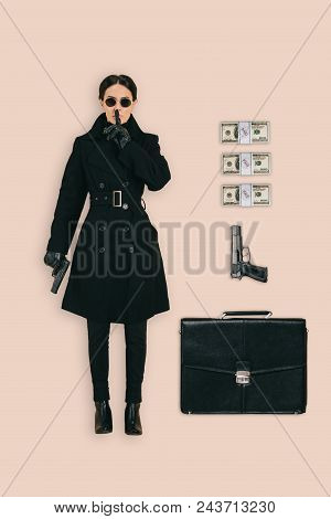 Top View Of Female Killer In Sunglasses Doing Shushing Gesture With Briefcase, Handguns And Cash Iso