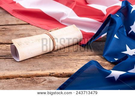 Usa Constitution Rolled In Scroll. Patriotic Flag Of Usa And Declaration Of The Independence Of Usa
