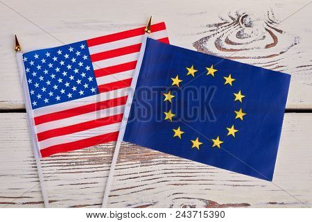 Small Flags Of Usa And Europe. Cocktail Flags Of America And Europe On Vintage Wooden Surface.