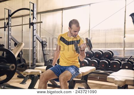 one young man, 25 years old, gym training on bike