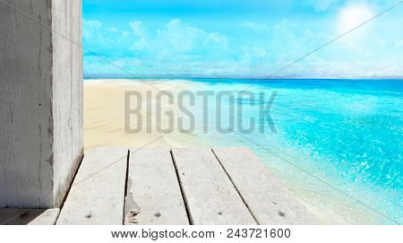 A view of the beach from a wooden, old pier.
