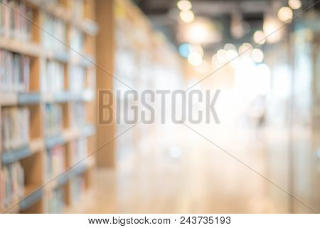 Abstract Blurred Public Library Interior Space. Blurry Room With Bookshelves By Defocused Effect. Us
