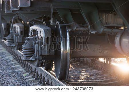 Wheels Of A Railway Train On Rails Close Up, Cargo Transportation