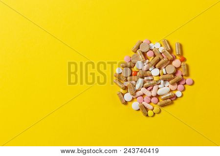 Medication White Colorful Round Tablets Arranged Abstract On Yellow Color Background. Aspirin, Capsu