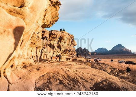 Wadi Rum, Jordan - December, 25, 2017: Tourists In The Dunes In Wadi Rum Desert In Jordan