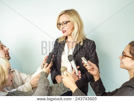 Woman Public Speaker And Girls Journalists, Hands Of Reporters With Tv Microphones And Voice Recorde