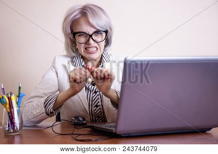 Angers, Stressed And Frustrated Business Woman Breaking Pencil As A Symbol Of The Difficulties And P