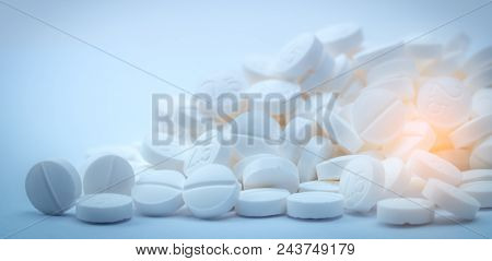 Pile Of White Tablets Pill Containing