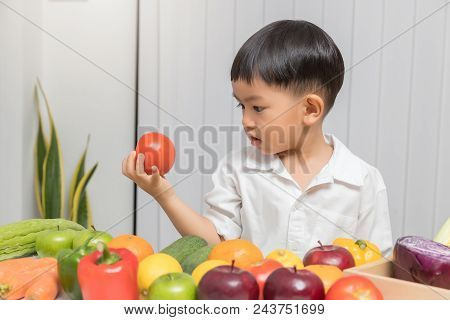 Healthy And Nutrition Concept. Kid Learning About Nutrition To Choose How To Eat Fresh Fruits And Ve