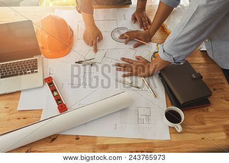 Architect Or Engineer Working On Blueprint, Architectural Concept. Engineer Discussing With Architec