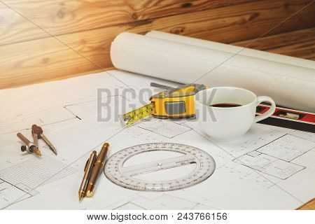 Cup Of Coffee With Measurement Tool And Blueprint, Architectural Concept
