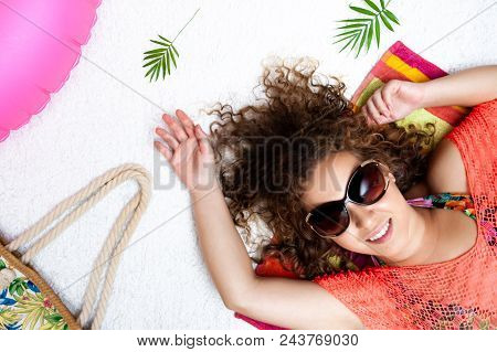 Top View Vacation Style Portrait Of A Lying And Relaxing Beautiful Woman With Summer Beach Accessori