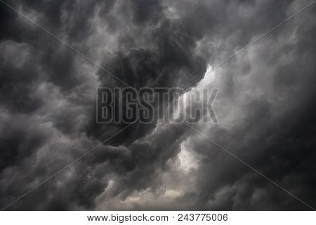 Dark or black clouds on the sky before storm raining.