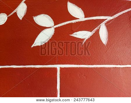 White Painted Leaves On Red Grungy Wall Texture Background.