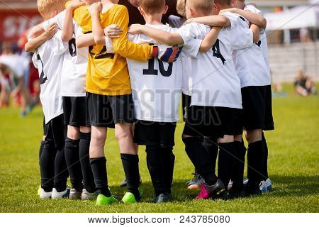 Kids Sports Team With Coach. Team Sports For Children. Young Boys Standing Together As A Teammates H