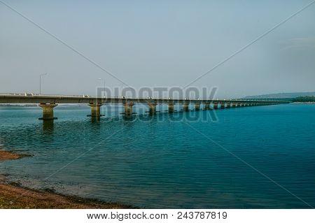Railway Bridge Across The River/ Boat On The Water On The Background Of The Railway Bridge Across Th