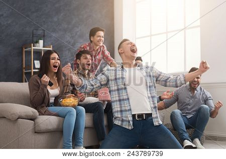 Goal. Very Excited Friends Having Fun By Watching Football Match And Eating At Home, Indoors. Friend