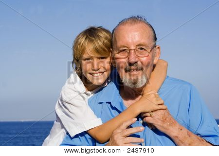 Happy Smiling Grandfather And Grandson