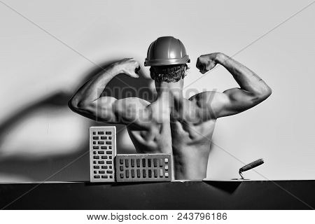 Building Materials. Handyman. Handsome Bearded Macho Man Builder With Sexy Muscular Athletic Strong