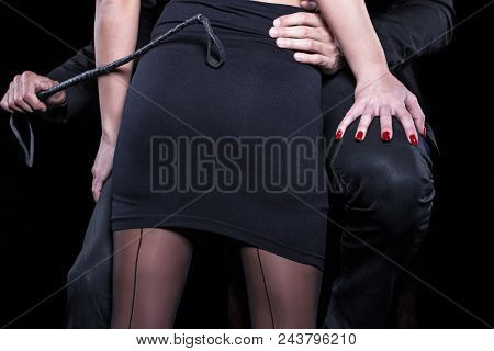 Dominant Man With Whip Holding Sexy Lover Closeup, Bdsm