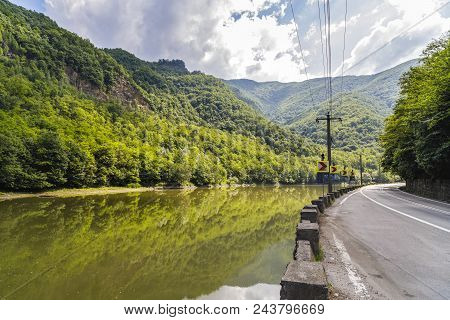 Highway Going Along The Olt River In Romania