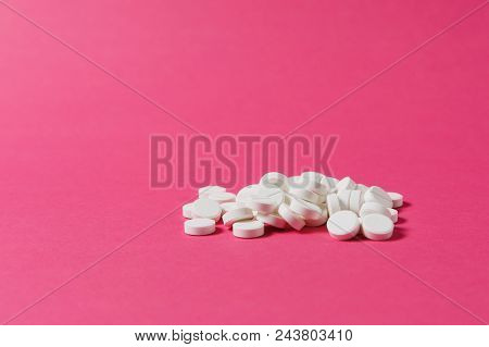Medication Pile White Round Tablets Arranged Abstract On Pink Rose Color Background. Aspirin, Capsul