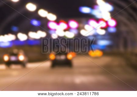 Night City View In Blur. City Street Blurry Photo. Streetlife Bokeh Image. Street View With Pedestri