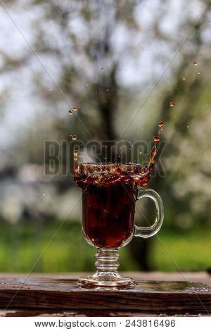 Coffee Splash In The Cup. Splash Outdoor. Splash In The Cup
