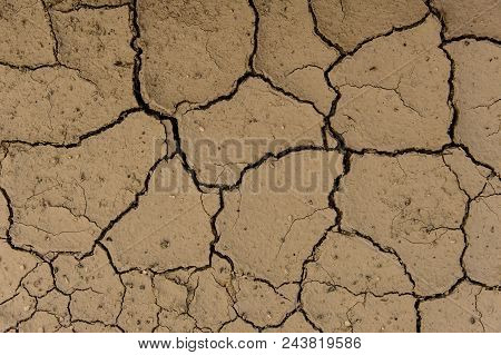 Dry Solid Ground Texture For The Background Image. Uneven Dry Ground Surface Background