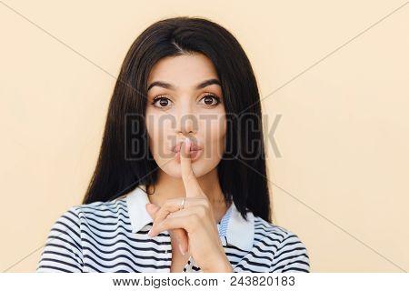 Secret Female Makes Hush Sign, Gossips With Best Friend, Keeps Index Finger On Lips, Has Long Dark H