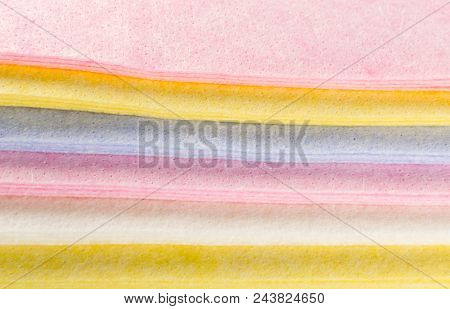 Pastel Color Fabric Background or Texture. Stack of Folded New Soft Color Cloth. Absorbent Microfiber Towels with Place for Text poster
