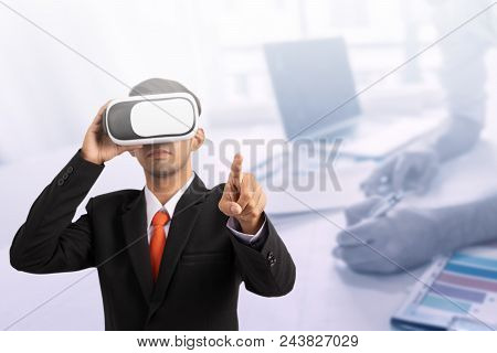 Close Up Of Male Hand, Young Man Wearing Virtual Reality Goggles In Modern Coworking Studio, Smartph