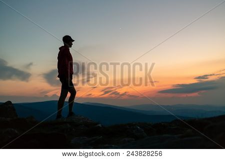 Man Celebrating Sunset On Mountain Top. Looking At Inspiring View. Trail Runner, Hiker Or Climber Re