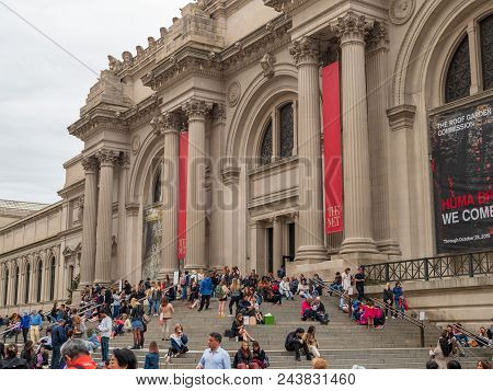 New York, Ny - May 18, 2018: Museum Goers And Tourists Rest Outside On The Steps Of The The Met (the