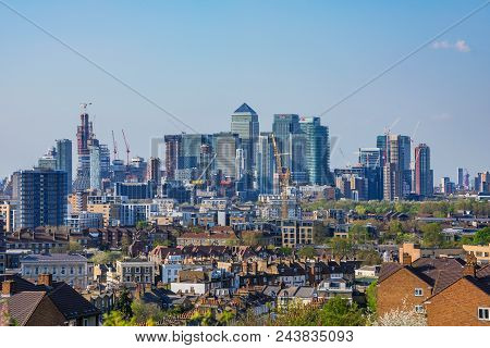 London, United Kingdom - April 20: View Of Greenwich Residential Area With Canary Wharf Skyscrapers