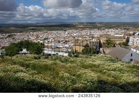 Panoramic View Of One Of The White Villages. Small Hamlet Of Southern Spain. Sky Full Of Cottony Clo