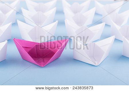 One Unique Pink Paper Boat Among Many Ones. Different Paper Ships As Individuality And Leadership Co