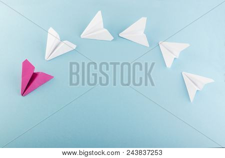 One Unique Pink Paper Plane Among Many Ones. Different Paper Airplanes As Individuality And Leadersh