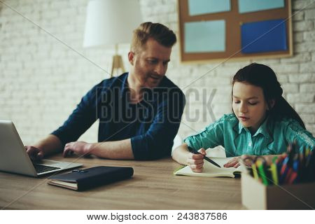 Single red haired father does business while daughter is doing homework at home. Child education concept. Fatherhood. poster