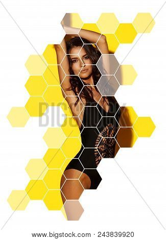 Young Sexy Slim Tanned Woman In Black Swimsuit Posing Against Yellow Background. Fashion Portrait Of