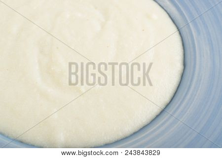 Semolina Porrige In Blue Plate Top View. Manna Croup Or Farina Boiled In Milk