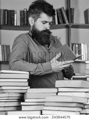 Man On Busy Thoughtful Face Reading Book, Bookshelves On Background. Education And Science Concept.