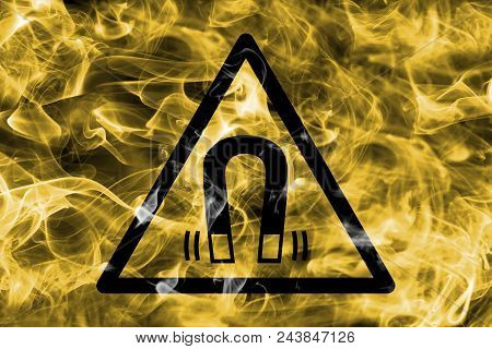 Magnetic Field Hazard Warning Smoke Sign. Triangular Warning Hazard Sign, Smoke Background.