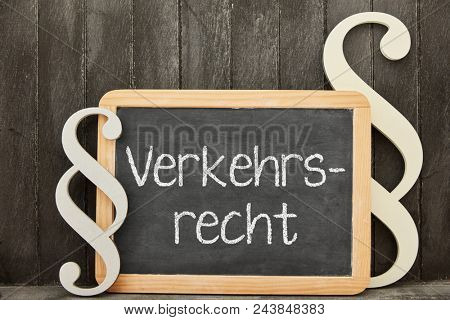 German word Verkehrsrecht (traffic law) as concept with law symbols beside a blackboard