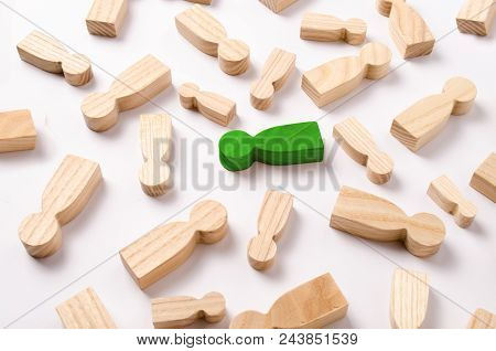Wooden Figures Of People Are Lying On A White Background. The Concept Of Human Resources Management.