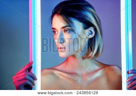 Sexy Woman In Neon Light In Lingerie. Neon Lights And Glare Of Light On The Girl's Face. Naked Woman